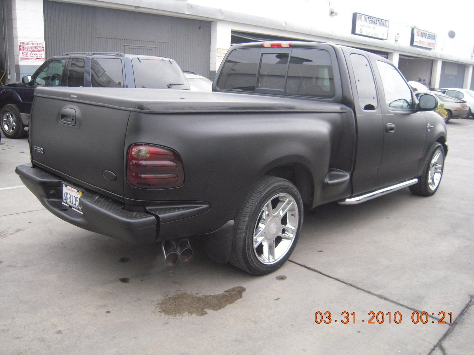 west-coast-body-and-paint-black-ford-f150-11